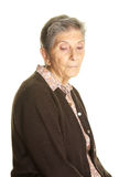 Hög kvinna som SAD ser på kameran Royaltyfri Fotografi