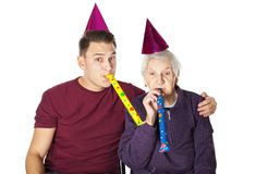 Hög kvinna & sonson som firar födelsedag royaltyfria foton