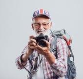 Hög lycksökare och fotograf Arkivfoton