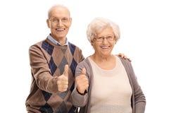 Hög man och kvinna som ger upp tummar Royaltyfria Bilder