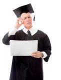 Hög mankandidat som rymmer tomma ark av papper och att tänka Arkivbild