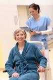 Hög patient i rullstol royaltyfri bild