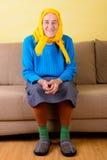 hög sittande kvinna Arkivfoto