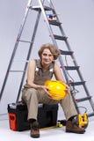 hög sittande toolboxkvinna Arkivfoto