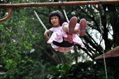 hög swing för flygflicka Royaltyfri Bild