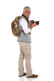 Hög turist som tillbaka ser Royaltyfri Foto