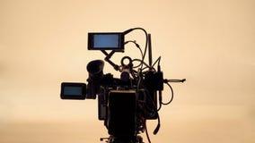 hög videokamera för defination 4K med tripoden Royaltyfri Foto