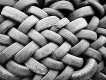Högar av använda gummihjul i svartvitt Royaltyfria Foton