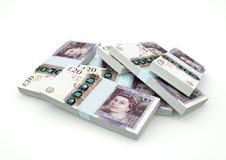 Högar av Förenade kungariket pengar som isoleras på vit bakgrund Arkivbilder