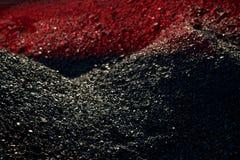 Högar av kol i röda ljuset royaltyfria foton