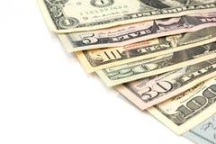 Högen av olika för dollarpengar för USA amerikanska räkningar fördelade som fansor Royaltyfri Bild