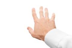 Höger hand för affärsman som försöker att gripa något arkivbild