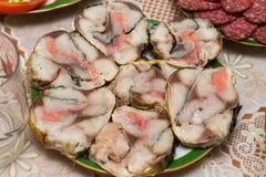 Högg av fiskfiléer Arkivbild