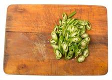 Högg av gröna Chili Peppers On Chopping Board III fotografering för bildbyråer