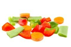 högg av grönsaker Rött, paprika, morot och Arkivfoton