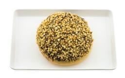 Högg av jordnötter för choklad munk Arkivfoto