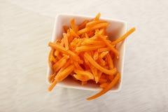 Högg av morötter Arkivfoto