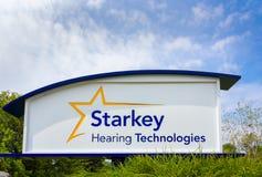 Högkvarter och tecken för Starkey utfrågningteknologier Arkivfoton
