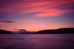 höglandLoch Ness scotland solnedgång Royaltyfri Bild