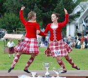 höglands- dansare Arkivfoto