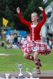 höglands- segra för dansarehäftig rörelse Arkivfoton