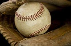 Högre serie i baseboll och handske Fotografering för Bildbyråer