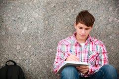 högskolestudent arkivbild