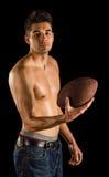Högskolestudent Holding Football royaltyfria foton