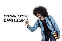 Högskolestudenthandstil talar engelsk text Arkivbilder