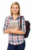 HögskolestudentWith Backpack And Digital minnestavla Royaltyfria Bilder