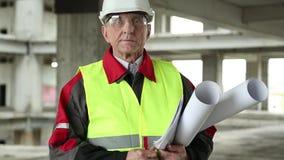 Högsta arkitekt på konstruktionsplatsen arkivfilmer