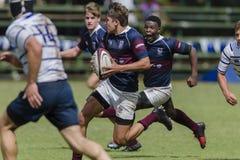 Högstadier för lag för rugbyhandling 1st Arkivbilder