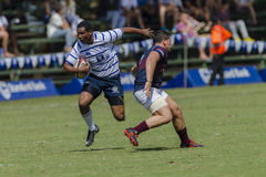 Högstadier för lag för rugbyhandling 1st Arkivfoto