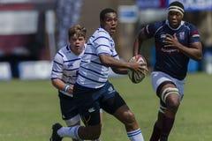 Högstadier för lag för rugbyhandling 1st Royaltyfria Foton