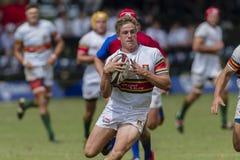 Högstadier för lag för rugbyhandling 1st Royaltyfri Foto