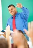 Högstadium: Lärare Calling On Student royaltyfri fotografi