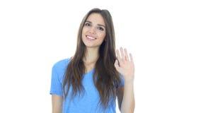 Högt Hello, vinkande hand för kvinna, välkomnande, stående på vit bakgrund royaltyfria bilder