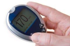 högt socker för blodglucometer Arkivbild