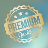 Högvärdig kvalitets- guld för rubber stämpel på en blå bokehdimmabakgrund Royaltyfria Bilder
