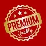 Högvärdig kvalitets- guld för rubber stämpel på en röd bakgrund Royaltyfria Foton