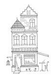 Högväxt hus med två torn, dekorativt arkitekturarv med en kaféstångbottenvåning Arkivfoto