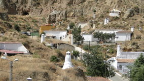 Höhlenwohnungen in Guadix, Spanien Stockfotos