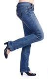 höjde jeansben Arkivfoto