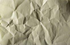 Höjdpunkt specificerad abstrakt förpackande guling rynkad pappers- textur Fotografering för Bildbyråer