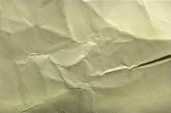 Höjdpunkt specificerad abstrakt förpackande guling rynkad pappers- textur Royaltyfria Foton