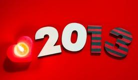 Hölzerne 2013-Jahr-Zahl mit einer brennenden Kerze Stockfotos