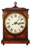 Hölzerne alte Uhr lokalisiert auf Weiß Lizenzfreie Stockbilder
