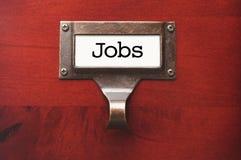 Hölzerne Büro-CAB-Datei mit Job-Aufkleber Stockbilder