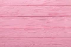 Hölzerne Beschaffenheit oder Hintergrund der Pastellrosa-Farbtabelle Stockfotografie