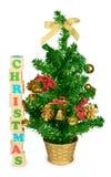 Hölzerne Blöcke, die das Wortweihnachten und -baum bilden Stockbilder